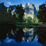 Cathedral Spires reflect in a flooded meadow in Yosemite National Park