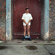 Professional 'Streaker' Mark Roberts exhibits himself by dropping his trousers near Liverpol docks.