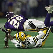 ..Green Bay's Donald Driver can't hold on to this pass while being defended by Minnesota's #29, Wasswa Serwanga in the 2nd quarter. .Green Bay Packers traveled to Minneapolis and the Metrodome to take on the Vikings Sunday December 17.  The Packers won 33-28.WSJ/STEVE APPS.