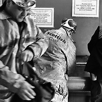 MINERS FILL THEIR WATER BOTTLES IN PREPARATION FOR THEIR TEN HOURS SHIFT UNDERGROUND AT LONGANNET COLLIERY, CULROSS. SCOTLAND, APRIL, 2001.