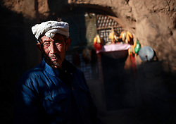 A picture made available on 06 November 2012 of 87-year-old farmer Chao outside his cave home or 'yaodong' in the rural outskirts of Yan'an city, Shaanxi Province China, 05 November 2012. The 'yadong' or cave dwellings are typical in the plateaus of northern China in Shaanxi Province where many of Yan'an's rural population still live in. They are mostly carved out from the yellow earth of the Loess hillsides and are about seven to eight metres deep with height and width of three metres. Former Communist leader Mao Zedong and his comrades are known to have hid in these cave homes during the civil war between the communists and nationalists in 1936 to 1948 as they battle the Kuomintang forces. Chao has lived in his cave home in the Loess mountains of Yan'an for more than 60 years, mostly in poverty and hardship as a farmer and was one of the few to have lived through the period of turmoil during the civil war. China's new leaders slated to take over during the 18th National Congress beginning on 08 November are likely to face mounting pressures to tackle the country's rising income inequalities between urban and rural areas that are often the source of simmering resentment and growing unrests on the grassroot level.
