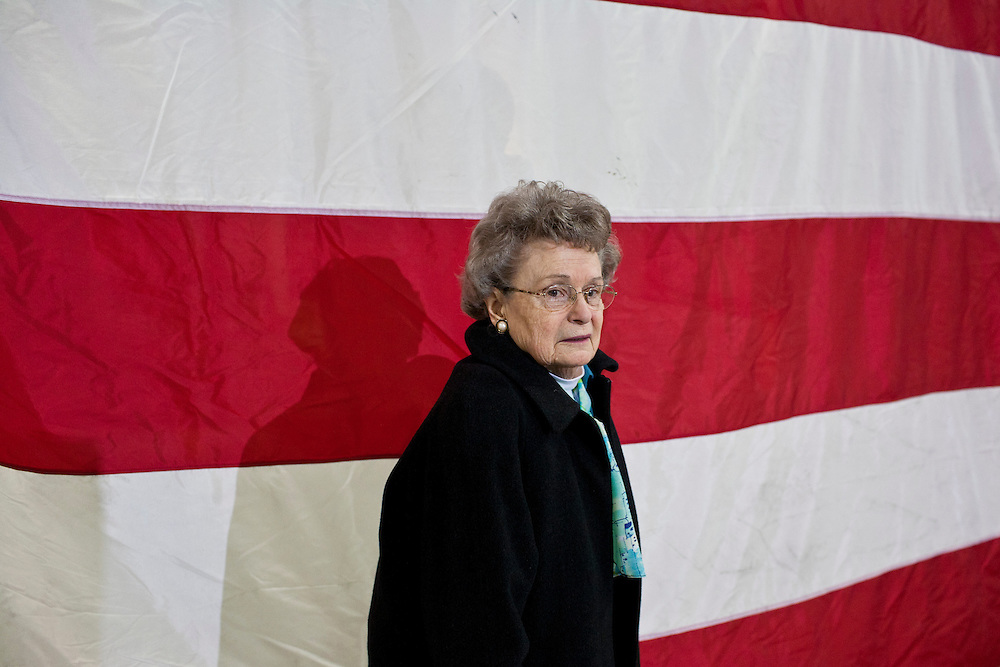 A woman arrives to hear Republican presidential candidate Mitt Romney speaks at a town hall meeting at the Diamond V South Plant on Friday, December 9, 2011 in Cedar Rapids, IA.