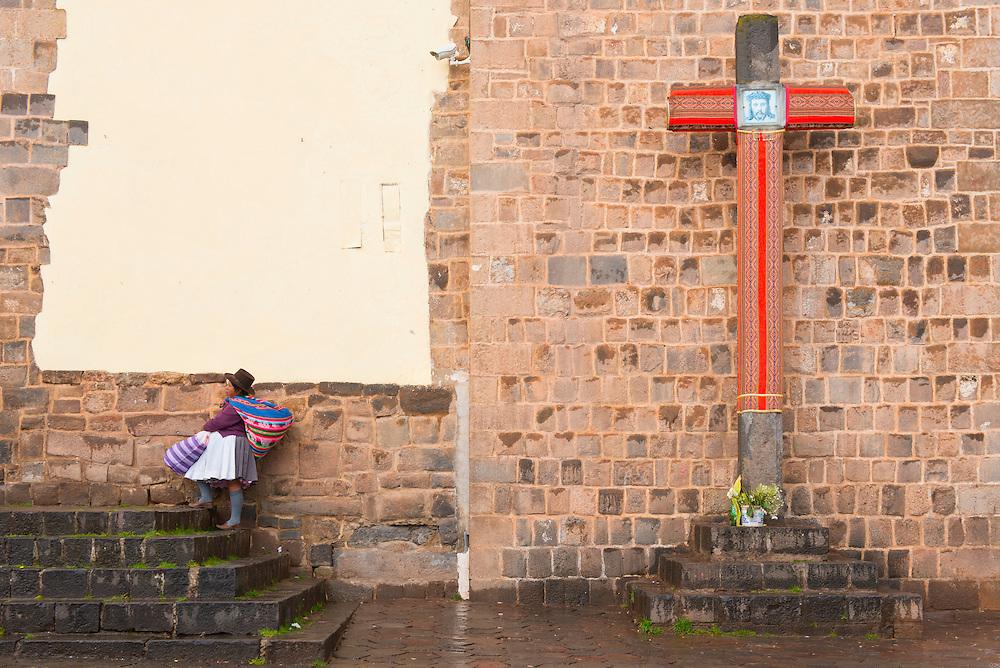 South America, Andes, Peru,Cusco, native woman passing church