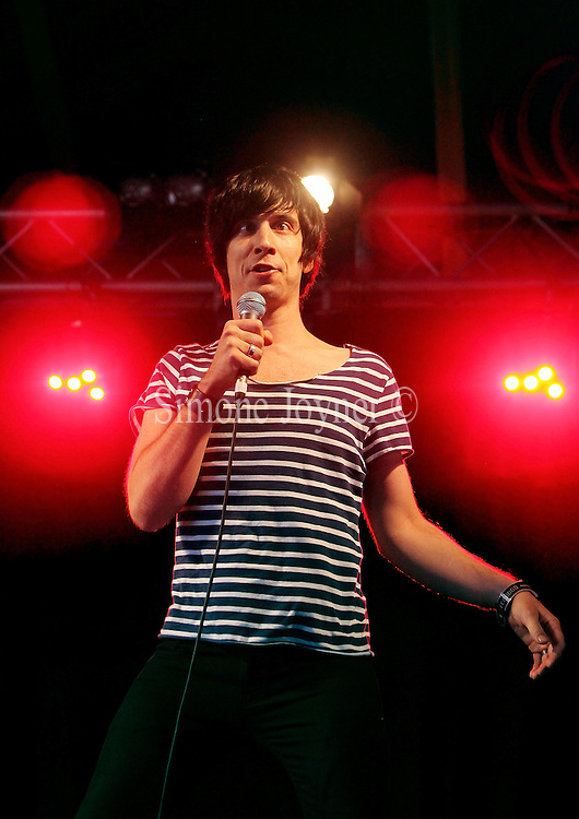 Comedian Russell Kane, winner of the Edinburgh Award 2010 performs live on the Alternative stage during the third and final day of Reading Festival on August 29, 2010 in Reading, England.  (Photo by Simone Joyner)