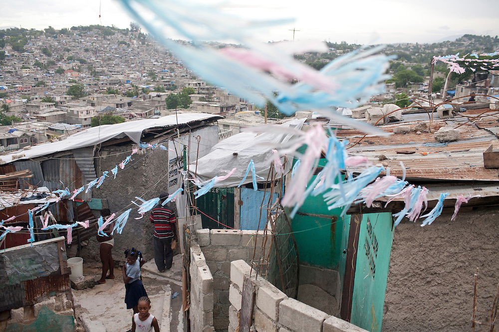 Plastic bags, strung up on a wire for decoration, flutter in the wind on July 13, 2010 in Port-au-Prince, Haiti.