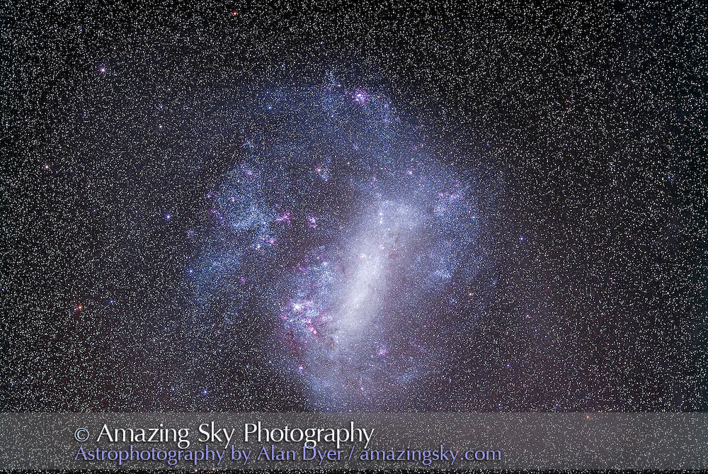 The LMC, Large Magellanic Cloud, taken with 135mm telephoto lens for a field of view similar to binoculars. Taken from Timor Cottage, Coonabarabran, NSW, Australia, Dec 5, 2012. This is a stack of 10 x 5 minute exposures, median combined (to eliminate some satellite trails) at f/2.8 with Canon L-series 135mm lens and the modified Canon 5D Mark II camera at ISO 800. Tracked on AP 400 equatorial mount.