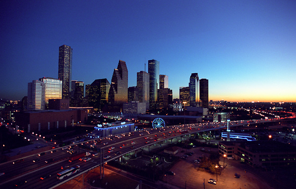 Aerial view of the downtown skyline with the Houston Aquarium ferris wheel.