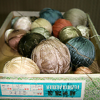 Asia, China, Beijing. Balls of silk threads for carpet weaving.