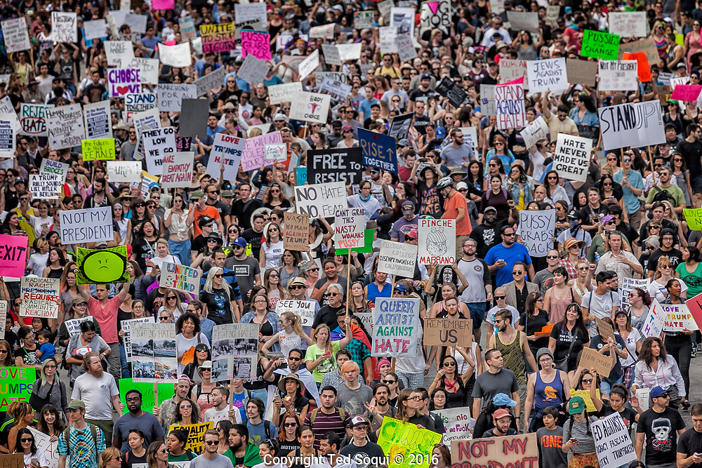Thousands of Anti-Donald Trump protesters peacefully marched from MacArthur Park to downtown Los Angeles Saturday, as demonstrations continued across the country.