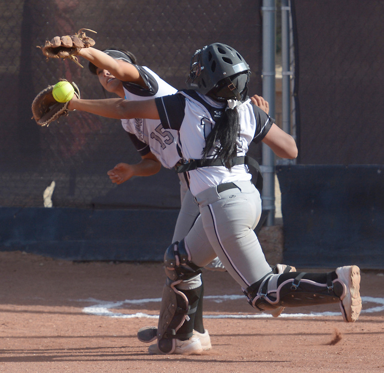 gbs040617n/SPORTS -- Volcano Vista's first baseman Samantha Trujillo, 15, and catcher Akia Marshall tangle after a foul ball during the game at Cibola on Thursday, April 6, 2017. (Greg Sorber/Albuquerque Journal)