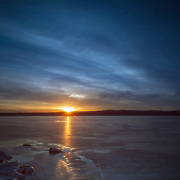 Stockton lake, frozen on a February afternoon, at sunset on a beautiful winter day.