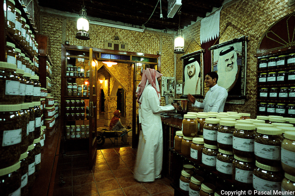 QATAR. Doha. Waqif souk. Spice shop...Like in the traditional souks, you can find in the Waqif souk spice shops? But the American standards of hygiene are in force and from now on the spices are sold in plastic bottles..