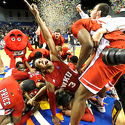 Western Kentucky Hilltoppers guard Kahlil McDonald (3) celebrates in the middle of a pile of his teammates after beating UNT Tuesday, March 6, 2012, during the Sun Belt Conference Basketball Tournament finals at the Summit Arena in Hot Springs, Ark. (Photo by Joe Imel/Daily News)