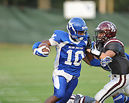 Water Valley's L.J. Hawkins (10) vs. New Albany's Mikey Wood (9) at Bobby Clark Field in Water Valley, Miss. on Friday, August 22, 2014. Water Valley won the season opener 36-33.