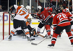 November 8, 2007; Newark, NJ, USA;  Philadelphia Flyers goalie Antero Niittymaki (30) looks for the loose puck as Philadelphia Flyers center Jeff Carter (17) battles with New Jersey Devils center Travis Zajac (19) and New Jersey Devils left wing Patrik Elias (26) during the second period at the Prudential Center in Newark, NJ.