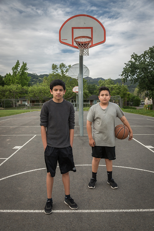 Eighth graders and best friends Carlos Salomon and Yahir Carrillo take a break from shooting hoops at Calistoga High School.