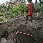Egg collector from Matupit Island digging for megapode eggs in the warm volcanic ash of Mt Tuvurvur, Rabaul, East New Britain, Papua New Guinea.