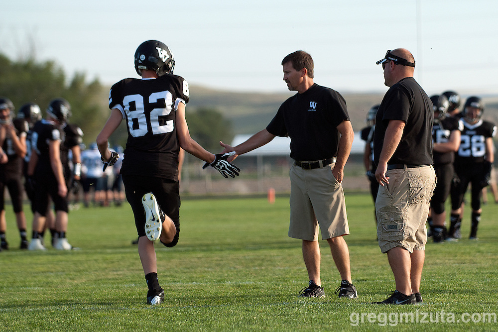 Garrett Harris and coaches Jeff Jacobs and Nate Aldred  before the start of the Vale LaGrande football game on September 20, 2013 at Frank Hawley Stadium in Vale, Oregon. Vale won the game 48-13 to improve to 4-0 on the season.