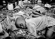 -  Children with cholera in Goma,Zaire. 1994 - <br /> The sun had set over the rwandan capital Kigali as president Juvenal Habyarimana's plane approached the city's airport on 6.april 1994.Suddenly, out of the darkness, a rocket hit the plane and sent it crashing to the ground, killing everyone on board.over the next three month's, more than 800.000 rwandans would be murdered, many cut down with machetes, killed by neighbours and countrymen, in a ferocious ethnic genocide that was all but ignored by the international world.