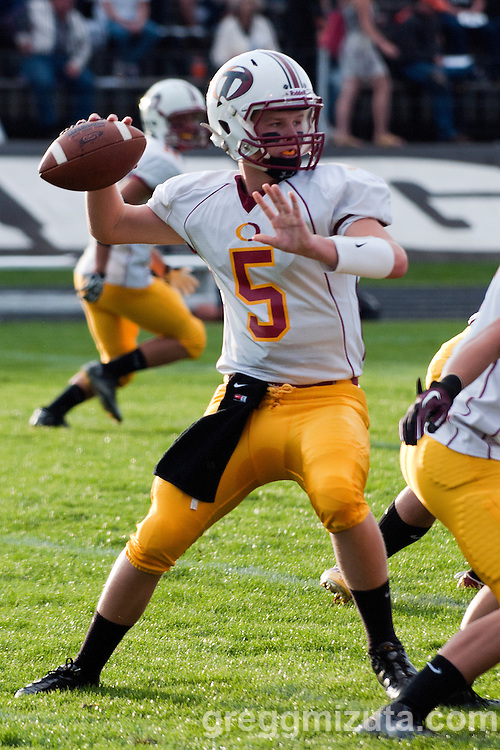 Ontario quarterback Trampis Waite set to pass during the Tigers 44-0 victory against Vale on September 16, 2011 in Vale, Oregon.