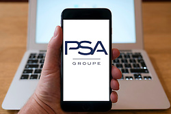 PSA Groupe motor manufacturing group logo on smart phone screen.