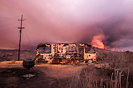 The Rocky Fire burns overnight near the town of Clear Lake, CA in Lake County, CA. The fire was over 13,500 acres and 5% contained as of Thursday evening. Hot and dry weather caused the fire to burn actively at night, threatening homes and downing power lines. At least three home were destroyed.