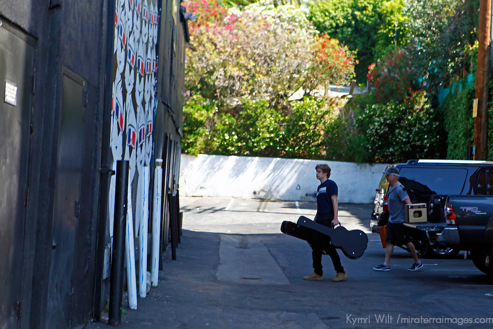 USA, California, Los Angeles. Band entering backstage at The Roxy Theatre concert venue on Sunset Strip in West Hollywood.