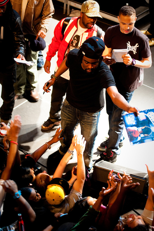 Wale, signing his vinyl.