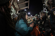 Protester address NYPD officer directly at the Anti_Trump rally at John F. Kennedy International Airport, after the Trump administration implemented a ban on entry to citizens of 7 Muslim-majority nations into the United States.  New York, New York, USA.  28 January 2017