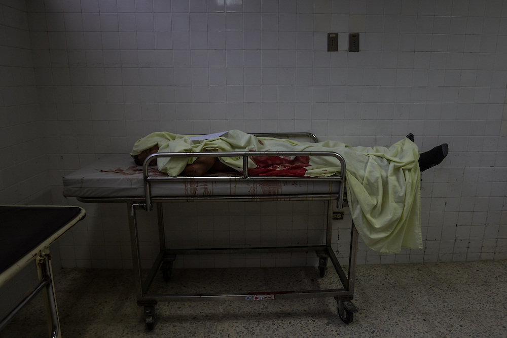 SAN PEDRO SULA, HONDURAS - MAY 25, 2014:  The body of a teenager who died of gunshot wounds in the morgue of a hospital in San Pedro Sula.     In 2008, forty 10 to 14 year olds were murdered in Honduras. Four years later, the number had doubled to 81, according to the Violence Observatory at the National Autonomous University of Honduras. Last year, 1,013 people under the age of 23 were murdered in a nation of 8 million. PHOTO: Meridith Kohut for The New York Times