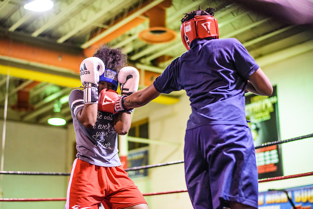 iBaltimore, Maryland - January 26, 2017: Mia &quot;Killer Bee&quot; Ellis, 16, left, spars with Aiyahnah &ldquo;Stringbean The Dream Killa&rdquo; Burke, 15, (foreground) at the Upton Boxing Club in Baltimore. <br /> <br /> CREDIT: Matt Roth for The New York Times<br /> Assignment ID: