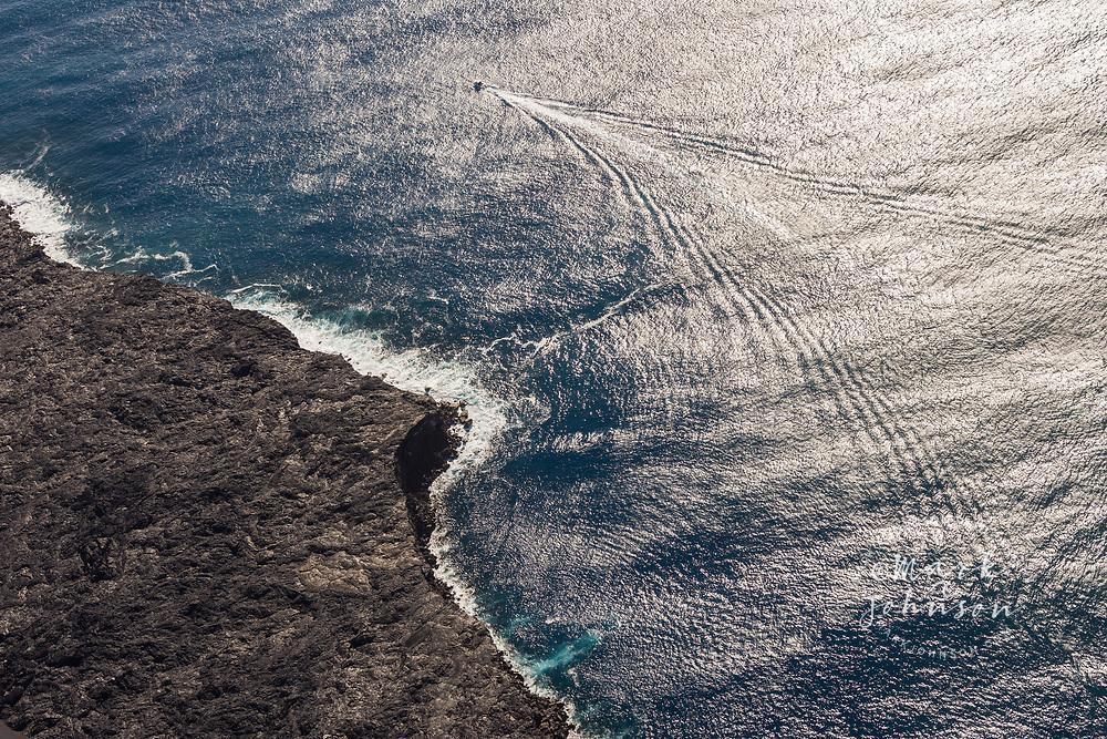 Aerial photo of a tour boat leaving the lava viewing area at Kamokuna, Hawaii Volcanoes National Park, Big Island, Hawaii