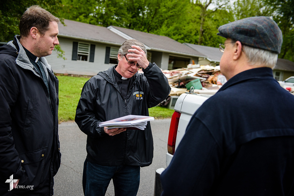 The Rev. Steve Gillmore (center) of First Lutheran Church, Neosho, Mo., talks with the Rev. Michael Meyer, manager of LCMS Disaster Response, and the Rev. Greg Mech (right), pastor of Immanuel Lutheran Church, Joplin, Mo., in a neighborhood on Wednesday, May 3, 2017, in Neosho. LCMS Communications/Erik M. Lunsford