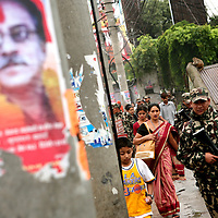 Members of the Nepalese army patrol the streets by a poster of the Maoist rebel supreme commander, Prachanda (?The Fierce One?) in Kathmandu on June 7, 2006. The ten-year old conflict in Nepal has claimed an estimated 13,000 lives. (Photo/Scott Dalton)