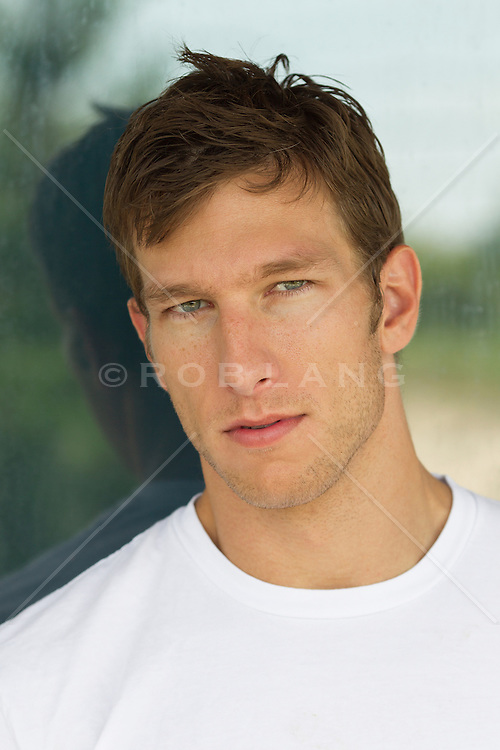 portrait of a good looking man in his early thirties with blue eyes