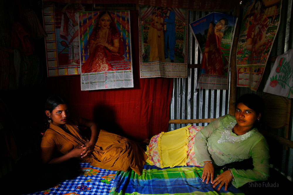 Sex workers Purnima, 16, right, and Pinky, 16,  are seen at brothel, July 7, 2007 in Dorothea, Bangladesh. They have been sex worker for 4 to 5 years. Pinky was born into the brothel. They are best friends.<br /> <br /> The majority of the 20,000 to 30,000 female sex workers in Bangladesh are victims of trafficking. <br /> Once they enter the brothel, usually before the age of 12, they are generally in for life because of social stigma and poverty. <br /> <br /> Children who are born into brothel have limited opportunity  due to a lack of education, social prejudice, and economic difficulty. Some girls have few options but to follow her mother's footstep as a sex worker, passing the orifession on to the next generation.