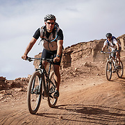 SHOT 10/14/16 4:05:07 PM - Biking down Murphy's Hogback on the White Rim Trail. The White Rim is a mountain biking trip in Canyonlands National Park just outside of Moab, Utah. The White Rim Road is a 71.2-mile-long unpaved four-wheel drive road that traverses the top of the White Rim Sandstone formation below the Island in the Sky mesa of Canyonlands National Park in southern Utah in the United States. The road was constructed in the 1950s by the Atomic Energy Commission to provide access for individual prospectors intent on mining uranium deposits for use in nuclear weapons production during the Cold War. Four-wheel drive vehicles and mountain bikes are the most common modes of transport though horseback riding and hiking are also permitted.<br /> (Photo by Marc Piscotty / &copy; 2016)