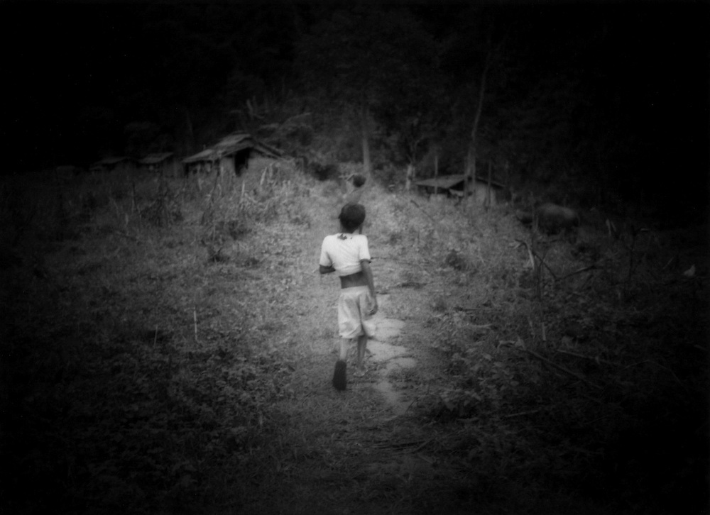Agta Negrito child goes home, Sawa, Sierra Madre Mountains, Luzon, Philippines.
