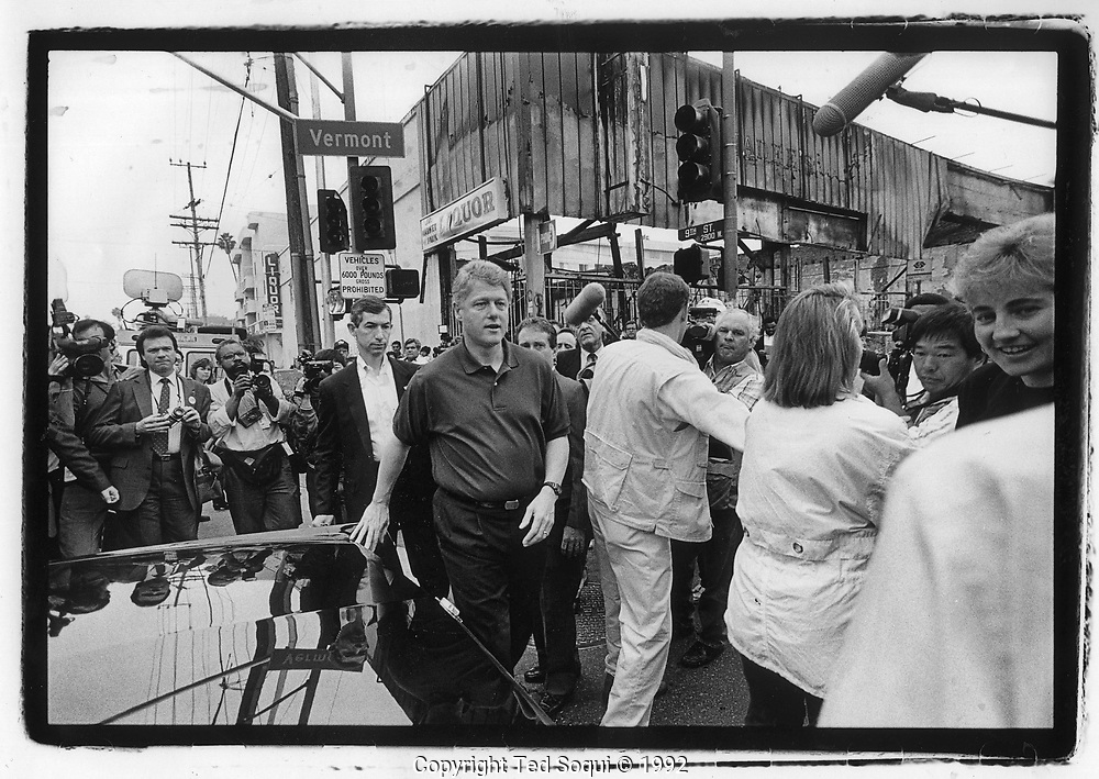 Presidential candidate Bill Clinton inspects riot damage at Vermont Ave and 9th street in Koreatown.