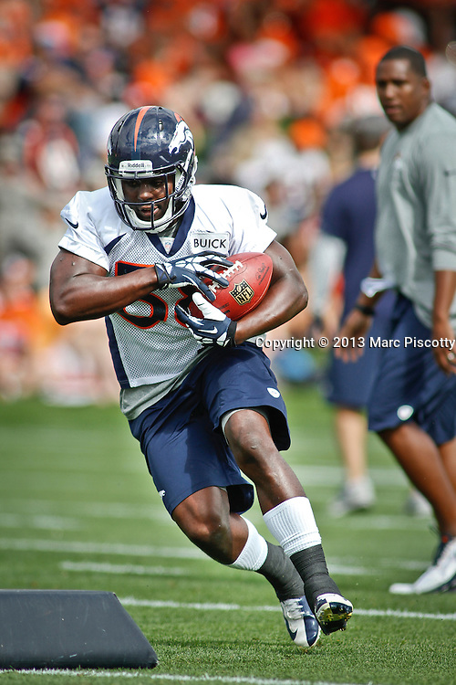 SHOT 7/25/13 9:36:13 AM - Denver Broncos rookie running back Montee Ball #38 runs through drills during opening day of the team's training camp July 25, 2013 at Dove Valley in Englewood, Co.  (Photo by Marc Piscotty / © 2013)