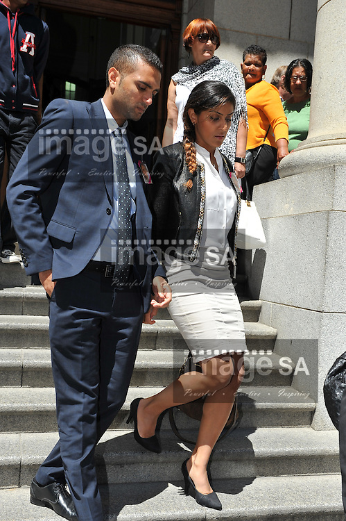 CAPE TOWN, SOUTH AFRICA - Tuesday 14 October 2014, Nishma Hindocha (right) leaves the court during Day 5 of the Shrien Dewani trial at the Western Cape High Court before Judge Jeanette Traverso. Dewani is caused of hiring hit men to murder his wife, Anni. Anni Ninna Dewani (n&eacute;e Hindocha; 12 March 1982 &ndash; 13 November 2010) was a Swedish woman who, while on her honeymoon in South Africa, was kidnapped and then murdered in Gugulethu township near Cape Town on 13 November 2010 (wikipedia).<br /> Photo by Roger Sedres