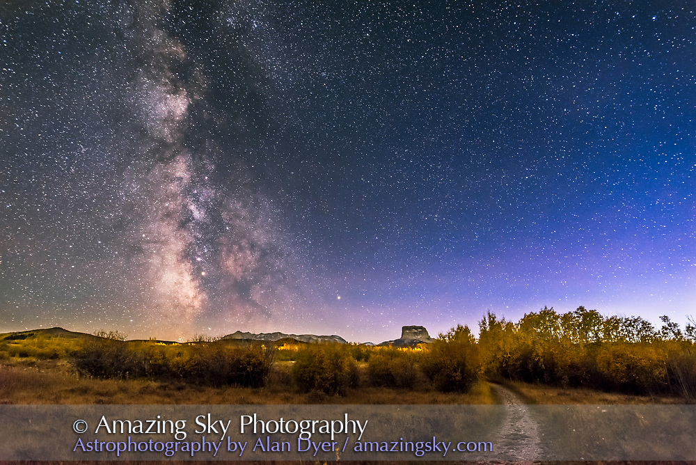 The summer and autumn Milky Way over Chief Mountain at Police Outpost Provincial Park, in southern Alberta, on September 26, 2016. Mars is just below M8 the Lagoon Nebula here. <br /><br />This is a stack of frames from the start of a time-lapse sequence with the western sky still blue with evening twilight. The ground is a stack of 8 exposures, mean combined to smooth noise, while the sky is from one exposure, the first in 400 in the time-lapse. Each exposure is 20 seconds at f/2.5 with the 20mm Sigma lens and Nikon D750 at ISO 6400.