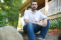 06/10/2015 - Plymouth, MA  - Adam Brewster poses for a photo in the front yard of his home in Plymouth, Massachusetts on June 10, 2015. Brewster has been helping to run his family business in the hearth industry since 2006 but has recently begun to pursue his passion of becoming a health and wellness coach. (Matthew Healey for The New York Times)