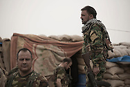 Iraq, Kurdistan: Peshmerga soldiers at a military base on the frontline agains IS in Sinjar. <br /> For more than one year between 2014 and 2015 Sinjar has been under ISIS control. When in November 2015 Peshmerga forces and Yazidi militias backed by US airstrikes entered the town and fully regained full control from IS, found the city heavily destroyed. Alessio Romenzi