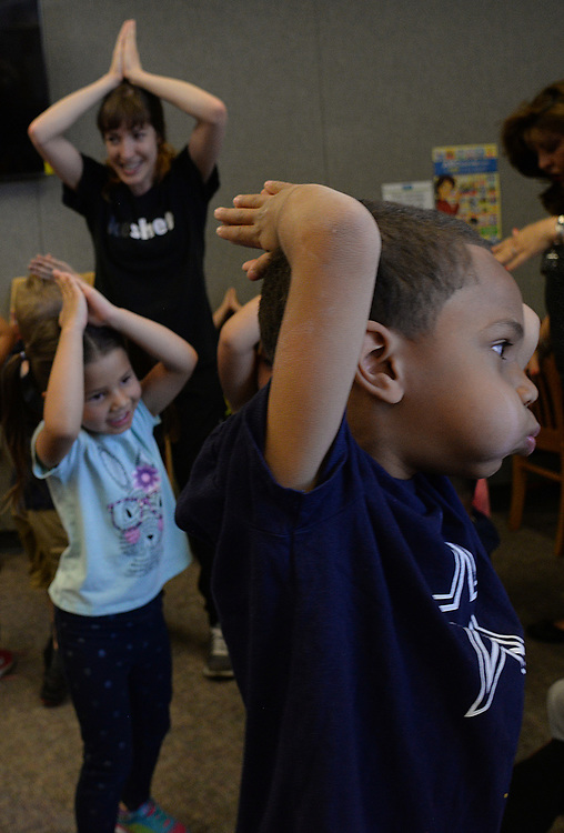 apl041217a/ASECTION/pierre-louis/JOURNAL 041217<br /> Alamosa Community  Center Child  Development students  Zyxier Jones,,5, right and Thyliah Jaquez,, , 5 , follow Keshet dancer Nichole Goodman,,'s  lead during a Jazz Dance workshop at the Alamosa Library.   .Photographed on Wednesday April 12, 2017. .Adolphe Pierre-Louis/JOURNAL