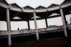 A lone silhouette wanders in an abandoned building, Yen Bai Province, Vietnam, Southeast Asia.