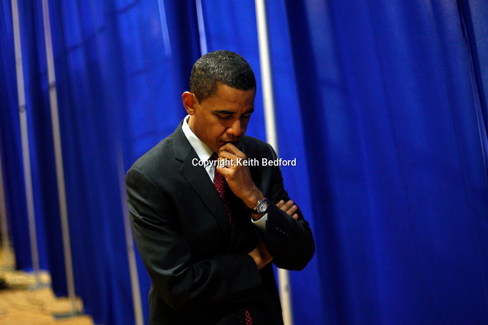 U.S. Democratic Presidential Senator Barack Obama waits to be introduced for a rally at Cornell College in Mt. Vernon, Iowa December 5, 2007.