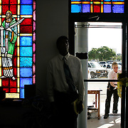 A young parishioner stands by as as others are checked by US Secret Service officers where Sen. John Kerry was attending church services at Mount Hermon AME Church Sunday, October 24, 2004, in Ft. Lauderdale, FL...Photo by Khue Bui