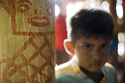 Past and future, a piece of the painted structure in the House of Knowledge at Itacoatiara Mirim, and a boy from this Baniwa Comunity.<br /> S&atilde;o Gabriel da Cachoeira town, Amazonas, Brazil.