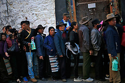 A picture made available on 19 September 2016 of Tibetan pilgrims queuing to enter the Jokhang Temple in the early morning in Lhasa, Tibet Autonomous Region, China, 09 September 2016. Jokhang Temple is considered one of the most sacred site for Tibetan buddhists built during the rule of King Songtsen Gampo in the 7th century.